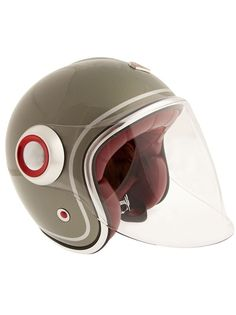 Green helmet from Ruby with a clear visor, maroon inner cushioning, chin strap and a designer inscription at the rear. There is a brand embossed plaque to the front. Motorcycle Helmet Design, Biker Helmets, Scooter Helmet, Scooter Girl, Vespa, Ruby Helmets, Retro Helmet, Scooter Design, Motor Scooters