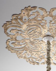 "Lace Pattern Ceiling Medallion  Horchow.com  Metal is cut into a lace pattern and hand painted for a gorgeous antiqued finish, adding enchanting character that instantly draws the eye upward.      Handcrafted of sheet metal.     Hand-painted light burnished-gold finish.     Six pre-drilled holes for attaching to ceiling; hardware not included.     32""Dia. x 0.25""D.     Imported.     Boxed weight, approximately 18 lbs.     $265.00"