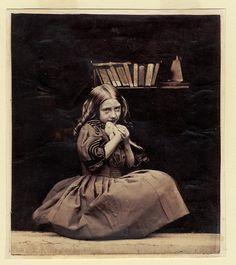 Little girl and books. Vintage photo.