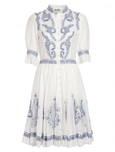 Feminine and achingly pretty, the ALICE by Temperley Rana Shirt Dress  is hard to resist. The soft cotton voile base has been intricately  embroidered with delicate contrast stitch work while the classic shirt  dress shape has been pepped up with a full skirt and ¾ sleeves that end  in delicate frills. With a nipped in waist and full buttoning front,  this is a summer must.           Fabric composition-100% Cotton        True to size        Standard dress length-hem falls above the knee…