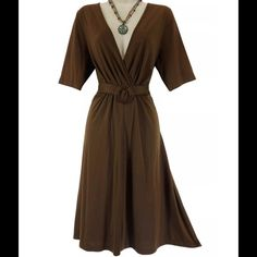 """Size XL Sexy ULTRA-SOFT CHOCOLATE DRESS This yummy chocolate dress is sexy, trendy, and fashionable!   Size: XL Slip on/ slip off Surplice neckline Chocolate Brown Ultra-soft, stretchy fabric Adjustable tie at the back of the waist Measurements: Bust (armpit to armpit):  41"""" relaxed - stretches to 50"""" Waist: 38"""" relaxed - stretches to 48"""" Hips:  48"""" unstretched Length: 41"""" (top of shoulder to bottom hem)  Condition:  PRISTINE CONDITION! Fabric Content: 65% Polyester  35% Rayon  Fabric Care…"""