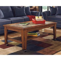 This gorgeous cocktail table features RTA construction with solid wood frames and casters. The beautiful natural slate tile inserts and rich warm finish makes this coffee table the perfect addition to