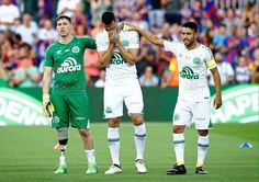 Chapecoense's Jakson Follman, Neto and captain Alan Ruschel are honoured by the Camp Nou crowd ahead of a friendly match v Barcelona. The home team won 5-0, but the result was not the point of the day. 09.08.17