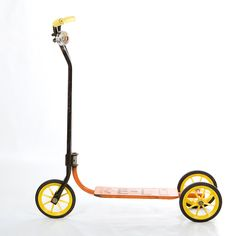 Vintage scooter with bell - Orange and black mid century scooter with yellow wheels and handles.
