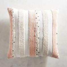Textured striping highlighted with the occasional sequin gives our pillow a warmth with a touch of glam.