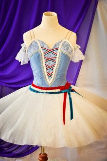 Another charming exclusive version of a professional tutu created for the ballet The Flames of Paris. This stage costume features a pale blue bodice with a deep V insert and a laced pattern reproducin
