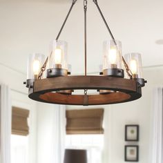 34 Brilliant Diy Wood Chandelier Design Ideas That You Must Try - Classic designs are widely diverse and include Victorian, Edwardian, Revival, Tudor and many other styles. Each era has different defining characteris. Wagon Wheel Chandelier, Chandelier Ceiling Lights, Chandelier Shades, Room Lights, Candle Chandelier, Hanging Lights, Dining Room Ceiling Lights, Outdoor Chandelier, Rustic Pendant Lighting