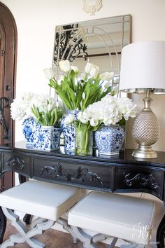 Spring Entryway. Blue ginger jars, white flowers