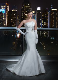 Justin Alexander signature wedding dresses style 9724 This strapless silk dupion envelop pleated bust line has a pearl and  crystal motif on the side waistline. Beaded and silk buttons cover the  back zipper and continue until the end of the chapel length train.