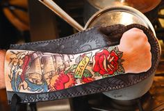 It's pretty hard to look tough while baking. But perhaps it's because you've never had a Tattoo Oven Mitt. It's the perfect way to protect your hand and look badass while doing it. Unless you're pulli