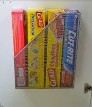 Door Holder for Wraps :: plastic magazine holder + double-sided adhesive • using removable tape, mark corners where holder is to be placed on inside of door • attach double-sided adhesive within corner marks • attach magazine holder to adhesive using corner marks as a guide • remove corner marks
