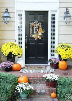 Affordable and oh-so-lovely, mums are the ultimate fall plant. Mallory of Style Your Senses used a mix of containers to set off the rainbow of blooms.   - HouseBeautiful.com