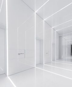 All-white corridor. Soho Fuxing Plaza by Aim Architecture.: