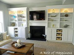 Love this family room! More built-ins on both sides of the fireplace.
