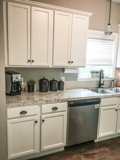 White kitchen. Painted cabinets. Update on a budget. DIY