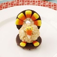 RICE KRISPIE TOM TURKEYS. So fun for kids to make as dinner favors for the Thanksgiving table. You'll need 12oz pkg chocolate chips, 11 oz bag candy corn, 52 fudge-striped cookies, 1/4 c butter, 4 c mini-mallows, 6 c crisp rice cereal, and 52 confetti sprinkles for the eyes. You dot each sprinkle with a toothpick dipped in chocolate.