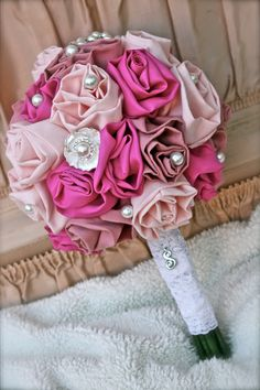 Handmade Fabric Rose Bouquet with Pearl and Rhinestone Brooches. $160.00, via Etsy.