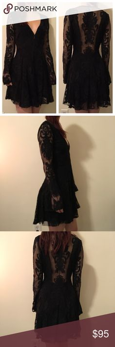 """FREE PEOPLE BLACK Black Gypsy Skater Dress FREE PEOPLE Black Gypsy Lace dress with a plunging neckline and an exposed open Lace back -zipper closure and is lined in cotton. Size 4. Bust measurements Are flat 18"""" waist 14"""" hips free length is 35"""" :) Free People Dresses Long Sleeve"""