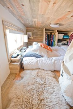 """A bedroom features shelves and a narrow space for hanging clothes. """"We don't store everything we have in here,"""" says Lisefski. """"We do have o..."""
