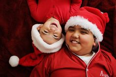 Brothers adorable Christmas card photo idea. Santa hats. Photography by Jesse Rinka.