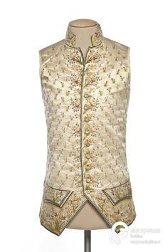 Waistcoat, 1781. Cream silk satin embroidered with floral sprays and naturalistic floral motifs in multicoloured silk thread.