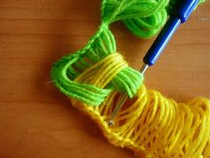 DIY Knitted Scarf Using A Hook - Find Fun Art Projects to Do at Home and Arts and Crafts Ideas
