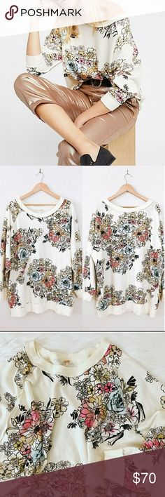 Free People | Go On Get Floral Pullover Comfy cotton pullover featuring a bold and elegant floral print allover. Ribbed accents at the scooped neckline, sleeve cuffs and waistband.  Machine Wash Cold Oversize fit Free People Tops Sweatshirts & Hoodies