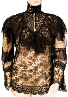 Description: 1880s Extra Long Plus Size Black Lace Sheer Blouse Top with Hand Tatted Lace Details, Fitted collar & Ruffle Detail at shoulders.