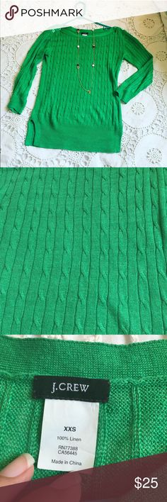 J. Crew Green Linen Sweater It's green and has buttons on the shoulders. You can dress it up to the office with a black pencil skirt or dress it down with jeans and it looks awesome either way  J. Crew Sweaters