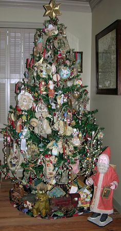 Antique Feather Tree, 7 ft with all antique and vintage ornaments ... Cottons, Scrap, and Glass ornaments.