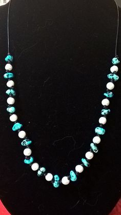 Knotted leather with black veined turquoise and pearls.