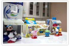Leuke knutsels met kosteloze materialen - knutselen met lege melkpakken - kartonnen winkeltjes dorpje