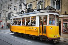 Lisbon Sightseeing: Top 10 Sights, Attractions and Day Trips for Lisbon, Portugal - via 10Best | Sightseeing in Lisbon allows you to discover celebrated landmarks, monuments and neighbourhoods. For a change of scenery, divert inland to Sintra and the magical Palácio da Pena. Alternatively, head along the coast and spend the day at Cascais Resort Town and enjoy some authentic holiday sightseeing by the sea. Photo: Tram 28, Lisbon