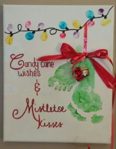 Candy cane wishes and Mistletoe kisses. Keaton and Raelyn's footprints and thumbprints for Christmas lights. 2014