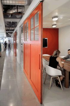 Bright, colourful sliding walls or partitions to add some personality and encourage creativity in meeting rooms