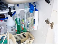 A tension rod, usually used for curtains, can be transformed into a brilliant solution for maximizing vertical-space storage in an under-sink cabinet. Organisation Hacks, Organizing Hacks, Kitchen Organization, Kitchen Storage, Organized Kitchen, Learning Organization, Organising, Bedroom Storage, Diy Organizer