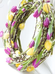 Love this twist for a spring wreath...I think i see some spirea woven in along with pussy willow and the tulips