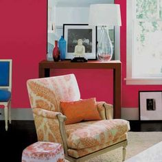 An uninhibited hot pink makes this parlor positively vibrate—especially against the crisp white molding. Mellow accents keep it from looking too childish. | Peony, @benjamin_moore