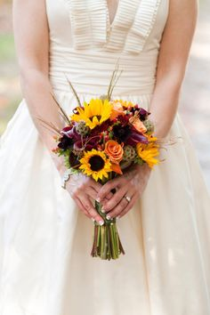 Golden sunflowers add warmth to this lovely bouquet