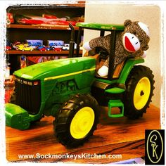 When we weren't looking, Nigel climbed into this #JohnDeere and took off. Click the pic for all of the #Sockmonkey photos