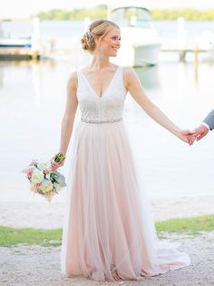Flow down the ceremony aisle in a pink, sheer chiffon wedding dress to showcase personal style and beauty.