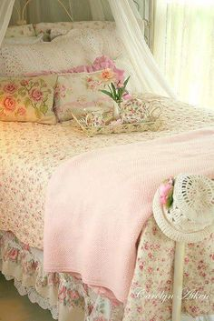 soft pink bedroom with flowery linens