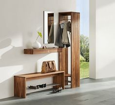 entrance hall - modern, but with all the right elements (mirror, bench, hooks, shelf)