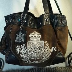 """Juicy Couture Velour Daydreamer Good used condition large Juicy Couture Daydreamer bag.  Has some wear spots on leather trim and handles and one corner.  Velour is very soft with some discoloration on the ends.  Interior shows signs of general wear and one pocket is worn.  It is missing the scarf.  16"""" w x 11"""" h with a 9"""" drop. Juicy Couture Bags Shoulder Bags"""