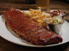 HICKORY-SMOKED RIBS Fall-off-the-bone tender St. Louis-style ribs, rubbed with our signature seasonings and basted with hickory barbecue sauce.