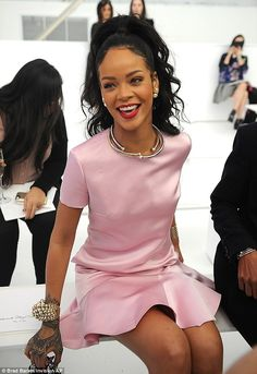 Pretty in pink: The 26-year-old tattooed diva looked ladylike in the short-sleeved silky frock, which she paired with Dior pumps, purse, and...