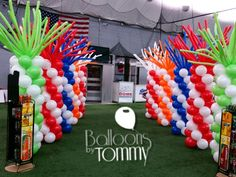 A colorful balloon column lined entrance ready for your guests to arrive | Balloons by Tommy | #balloonsbytommy