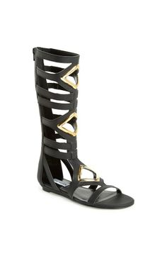 Spring fashion - will be pairing these gold and black gladiator sandals with a flowy shift dress.