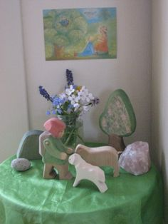 Spring nature table... i like the little person, sheep and trees