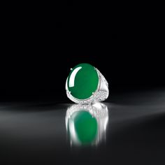 MAGNIFICENT JADEITE, MOTHER-OF-PEARL AND DIAMOND RING Estimate: HK$12,000,000 - 15,000,000 US$1,540,000 - 1,900,000 Cabcohon measuring approximately 21.19 x 17.47 x 6.29mm.